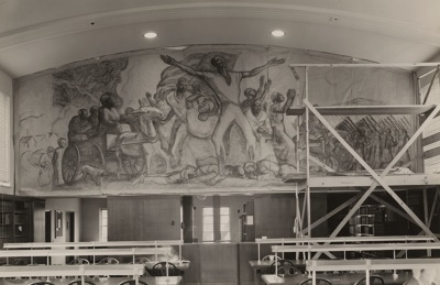 The mural as sketched by the artist before painting, with scaffolding in front.