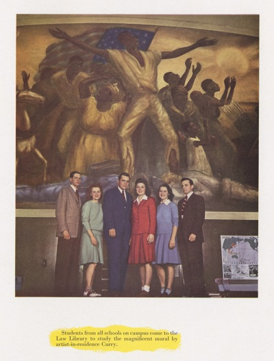 A colorized image from the 1940s of students standing on the circulation desk in front of the mural.