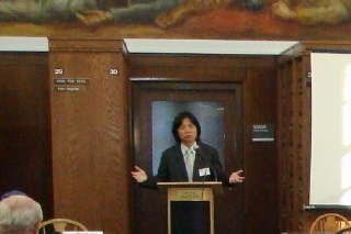 Asian male at podium