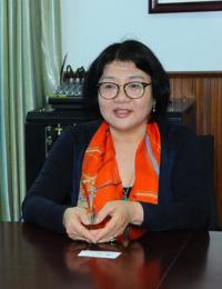 woman with Asian facial characteristics sitting