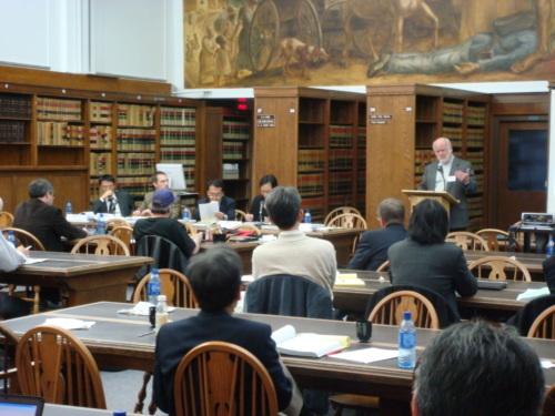 elderly Caucasian male at podium