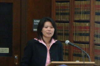 Asian female at podium