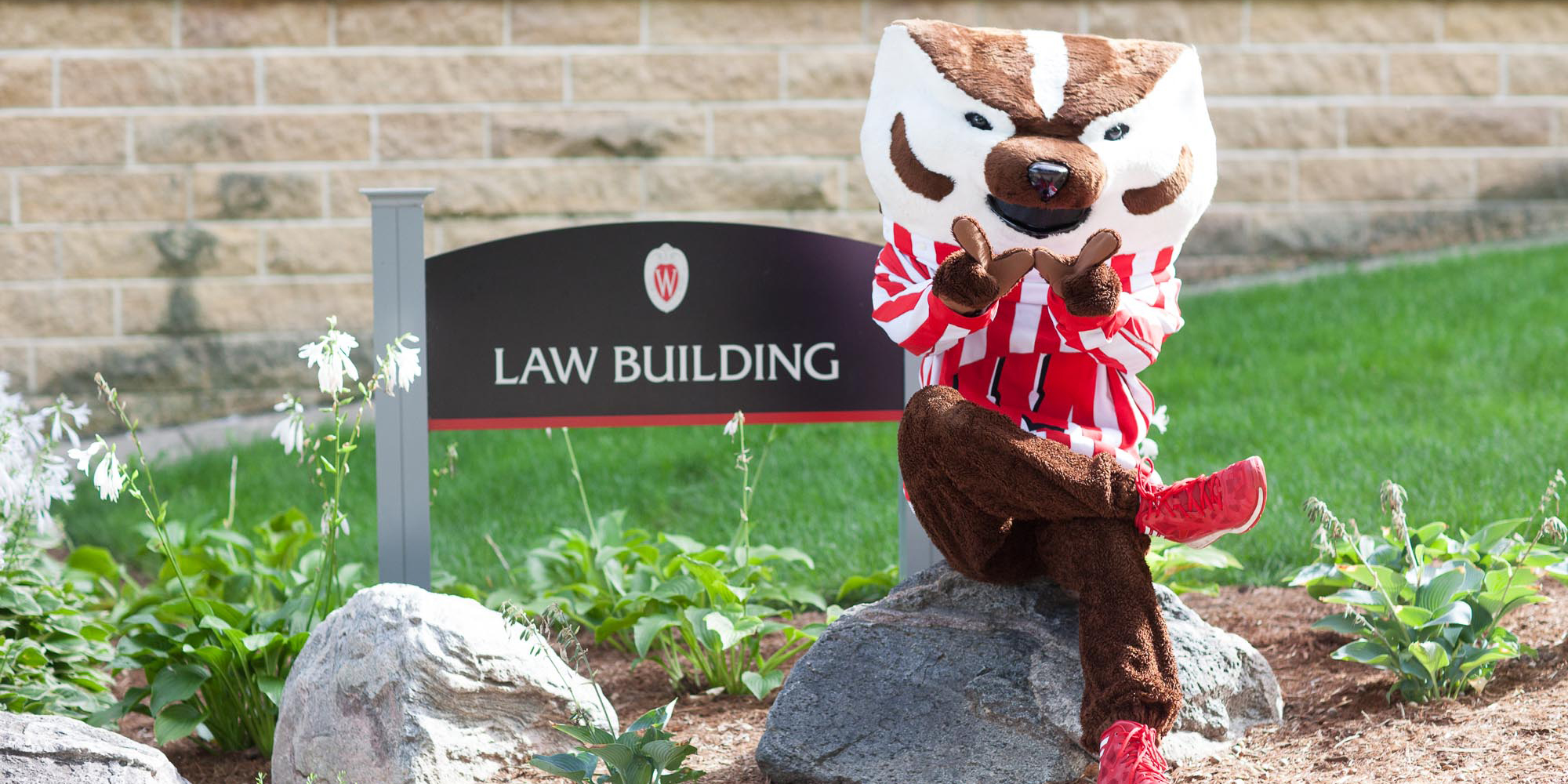 Bucky Badger with Law Building sign