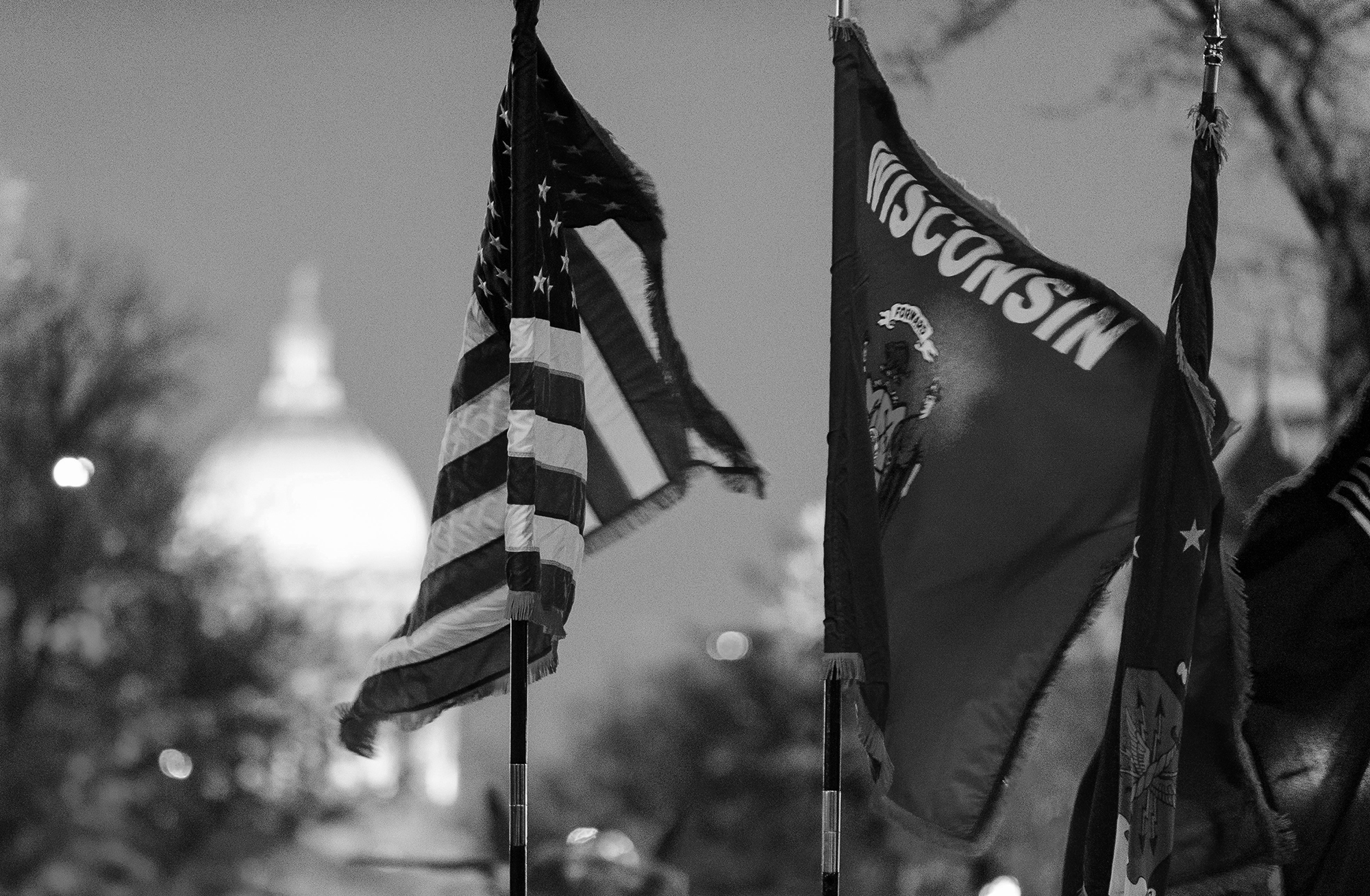 Wisconsin and U.S. flags with Wisconsin capitol