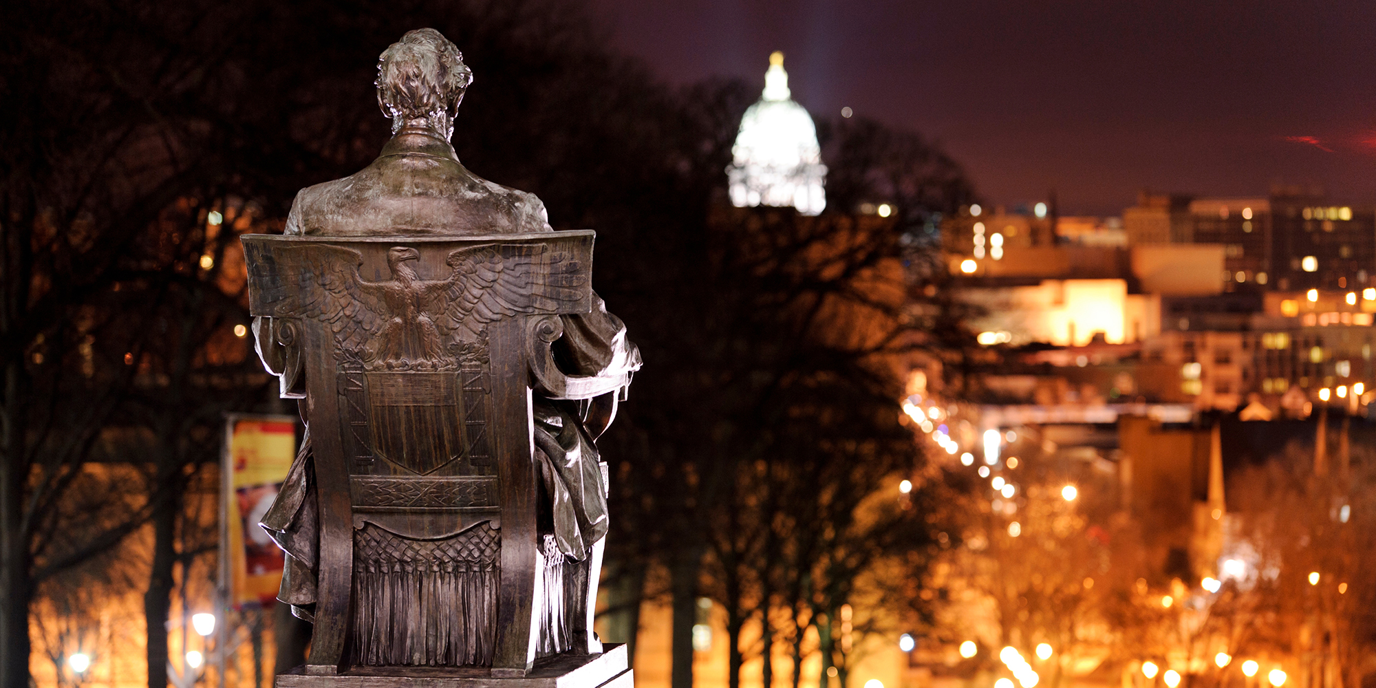 Abe Lincoln statue looking over Bascom Hill and Capitol Square