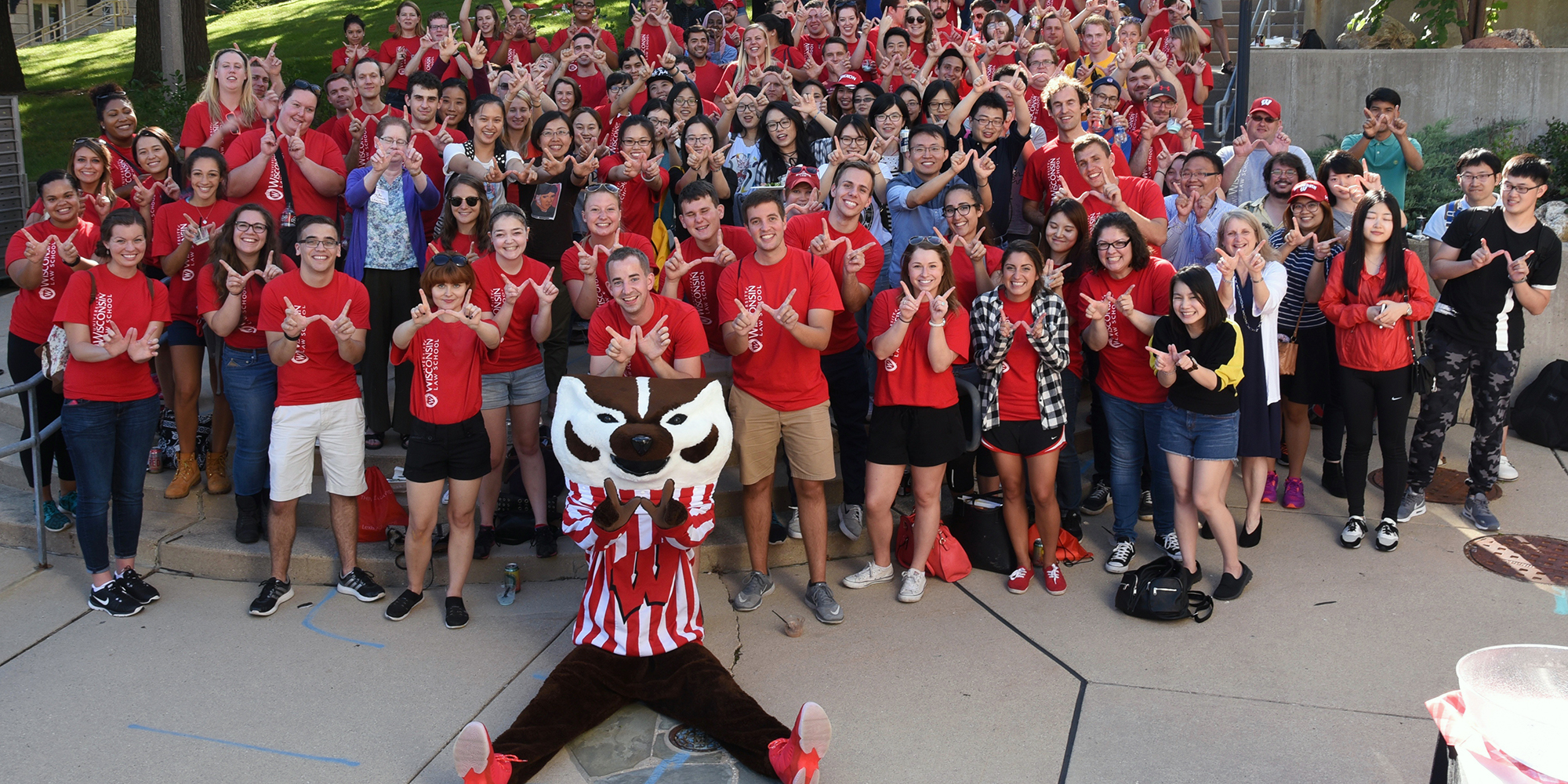 Bucky Badger with UW Law students on plaza