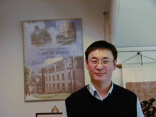Professor Amarsanaa, pictured with the Law School poster behind him.