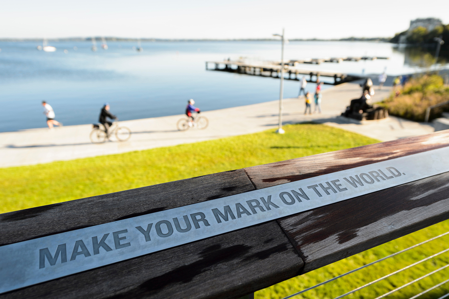 Alumni park sign that says 'make your mark on the world'