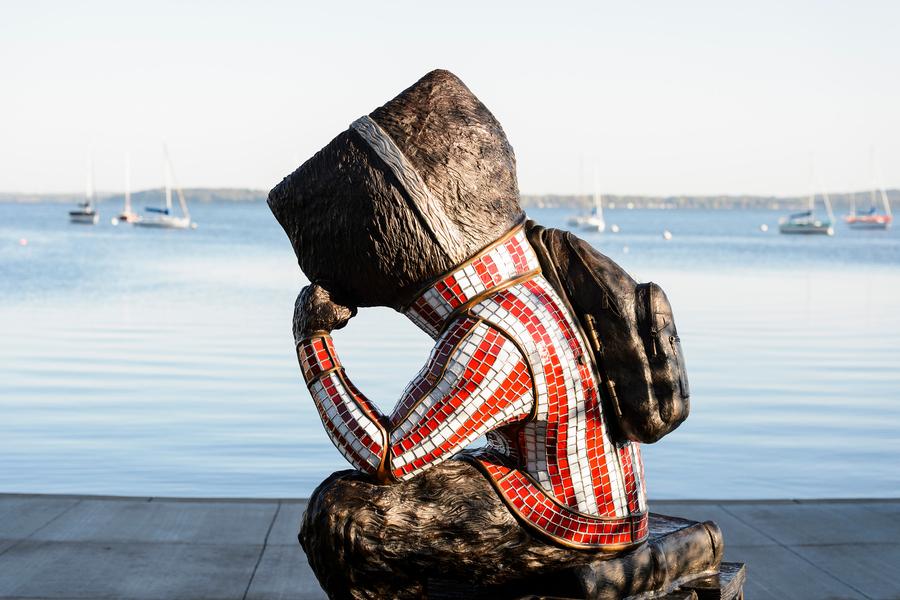 statue of bucky overlooking lake mendota at alumni park