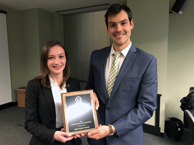 Law students Longley and Drozd holding their Best Brief award