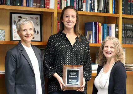 2018 Best Brief Winner, Laura E. Schroeder (at center), with Professor Trina Tinglum and Dean Raymond