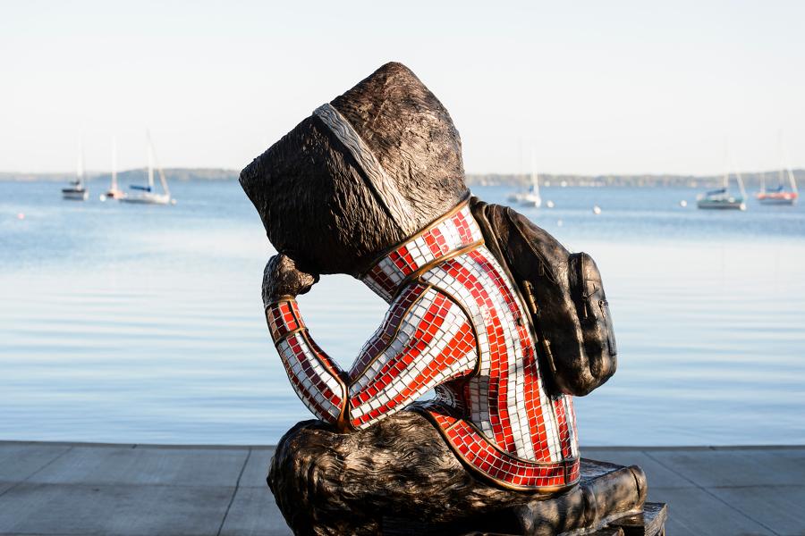 pensive bucky statue at alumni park by lake monona