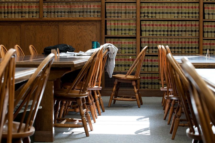 UW Law Library with sweatshirt over chair and coffee mug on table